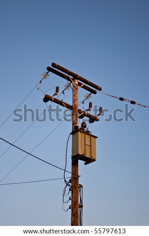 Lamps and telephone poles - stock photo