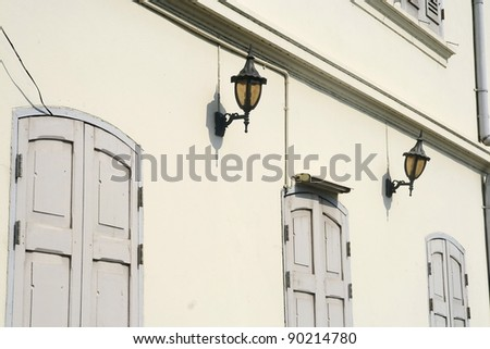 lamps on classic building wall