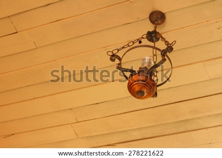 Lamps on the ceiling above the background light brown. - stock photo