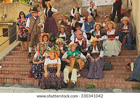 "LANCIANO, ITALY - SEPTEMBER 8: Singers and musicians in traditional dress performs popular italian music and songs during the town feast ""Il Dono"" on September 8, 2015 in Lanciano, Abruzzo, Italy"