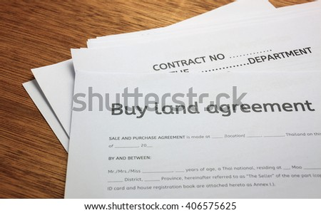 Land Contract Form On Wood Background Stock Photo