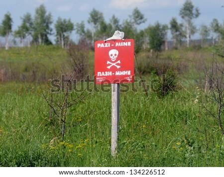 land mines field warning sign - stock photo