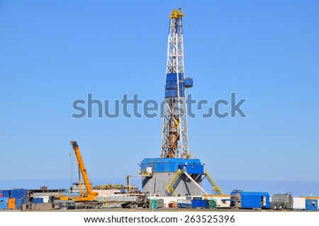 Land rig during the drilling operation - stock photo