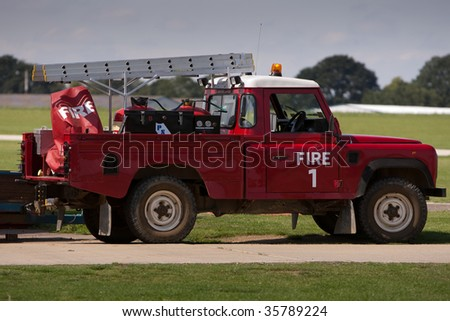Land Rover fire truck parked at the ready on an airfield - stock photo