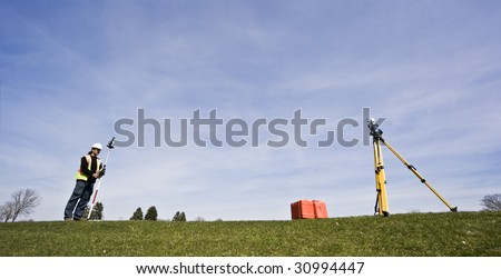 Land Surveying during the spring - stock photo