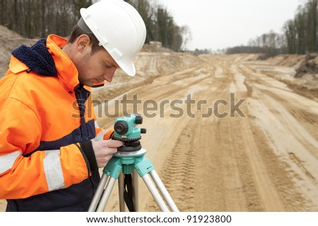 Land surveyor working on a construction site. - stock photo