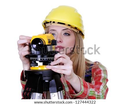 Land surveyor working with theodolite isolated on white - stock photo