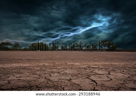 Land to the ground dry and cracked. With lightning storm - stock photo