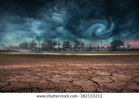 Land to the ground dry and cracked. With storm - stock photo