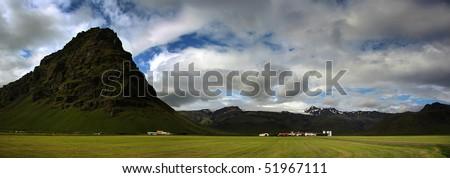 Land under glaciers - Farms under eyjafjallajokull glacier. Southern Iceland - stock photo