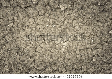 Land with a dry cracked ground , season water shortage - stock photo