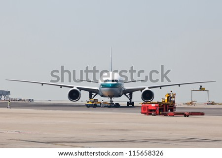 Landed aircraft on the apron - stock photo