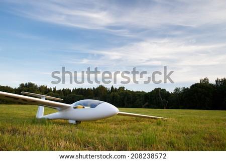 Landed sailplane on ground - stock photo