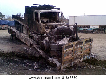 LANDI KOTAL, PAKISTAN - JUL 28: A view of burnt NATO vehicle which was set ablaze by unknown miscreants on July 28, 2011in Landi Kotal, Pakistan.
