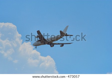 Landing Airplane - stock photo