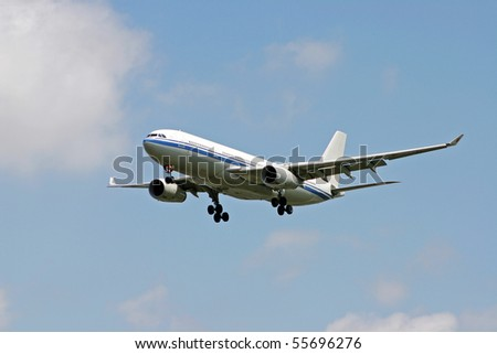 Landing airplane near the airport. - stock photo
