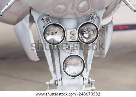 Landing Gear Lights of a Jet Airplane - stock photo