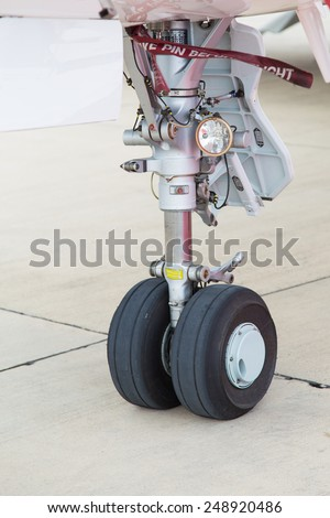 Landing Gear of a Jet Airplane in Ground - stock photo