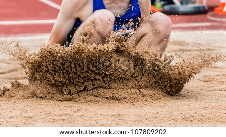 landing in long jump in track and field - stock photo