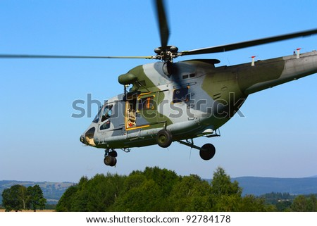 Landing military transport helicopter. Czech Air Force. A member of NATO. - stock photo