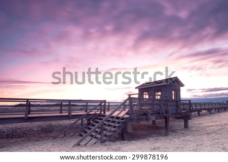 landing stage early in the morning at the beach of North sea