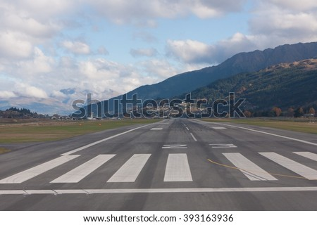 Landing strip of Queenstown from airplane, Otago, Southland, New Zealand - stock photo
