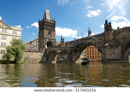 Landmark Charles Bridge in Prague, Czech Republic, seen from the water. - stock photo