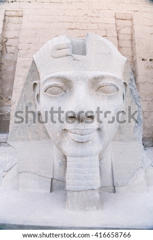 landmark sculpture statue of head and face pharaoh Ramses II, in monument Luxor temple, in Thebes ancient city, Egypt, Africa - stock photo