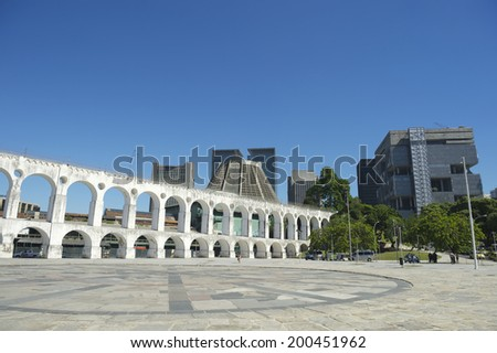 Landmark white arches of Arcos da Lapa at the skyline in Centro of Rio de Janeiro Brazil - stock photo