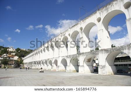 Landmark white arches of Arcos da Lapa in Centro of Rio de Janeiro Brazil - stock photo