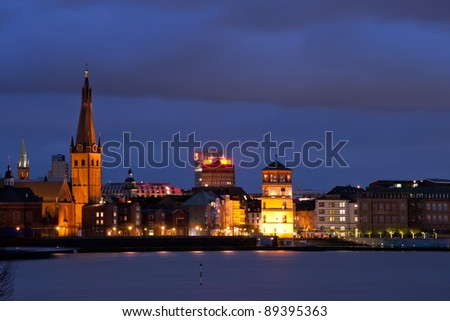 Landmarks of Old City (Altstadt) Dusseldorf at night - stock photo
