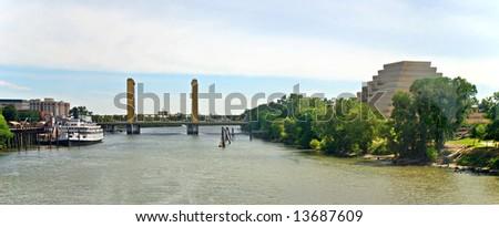Landmarks of Sacramento, California: Delta King Riverboat, I Street Bridge, Sacramento River and the Ziggurat Pyramid Building. - stock photo