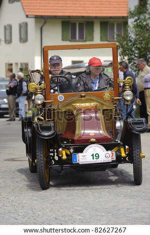 LANDSBERG, GERMANY - JULY 9: Oldtimer rally for at least 80 years old antique cars with Renault, built at year 1911, photo taken on July 9, 2011 in Landsberg, Germany - stock photo
