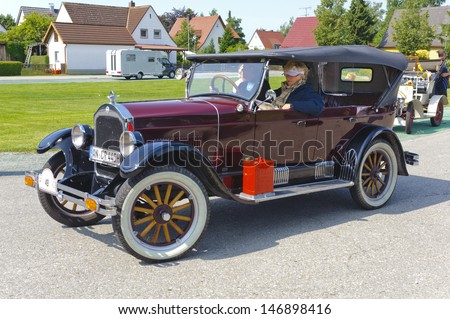 LANDSBERG, GERMANY - JULY 13: Oldtimer rallye for at least 80 years old antique cars with Durant Rugby R6 Tourer, built at year 1926, photo taken on July 13, 2013 in Landsberg, Germany