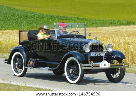 LANDSBERG, GERMANY - JULY 13: Oldtimer rallye for at least 80 years old antique cars with Ford A Cabriolet, built at year 1928, photo taken on July 13, 2013 in Landsberg, Germany