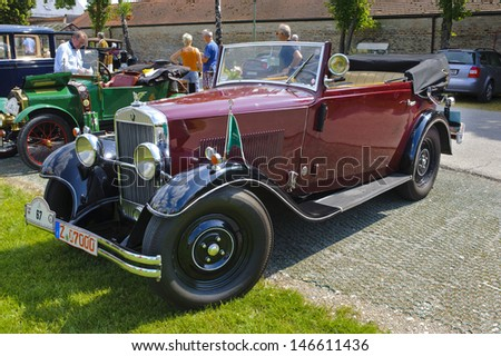 LANDSBERG, GERMANY - JULY 13: Oldtimer rallye for at least 80 years old antique cars with Wanderer W10 6-30 Cabriolet, built at year 1930, photo taken on July 13, 2013 in Landsberg, Germany