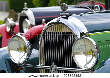 LANDSBERG, GERMANY - JULY 12, 2014: Public oldtimer rally in Bavarian city Landsberg for at least 80 years old veteran cars with a front view of Hotchkiss, built at year 1930 - stock photo
