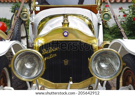 LANDSBERG, GERMANY - JULY 12, 2014: Public oldtimer rally in Bavarian city Landsberg for at least 80 years old veteran cars with a front view of De Dion Bouton, built at year 1912 - stock photo