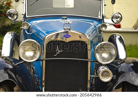 LANDSBERG, GERMANY - JULY 12, 2014: Public oldtimer rally in Bavarian city Landsberg for at least 80 years old veteran cars with a front view of Ford A de Luxe, built at year 1930 - stock photo