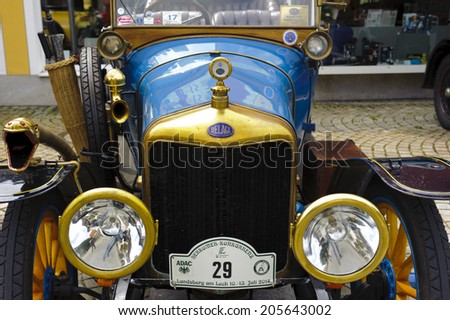 LANDSBERG, GERMANY - JULY 12, 2014: Public oldtimer rally in Bavarian city Landsberg for at least 80 years old veteran cars with a front view of Delage B1 Tourer, built at year 1915 - stock photo