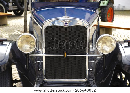 LANDSBERG, GERMANY - JULY 12, 2014: Public oldtimer rally in Bavarian city Landsberg for at least 80 years old veteran cars with a front view of Wanderer W10, built at year 1927 - stock photo