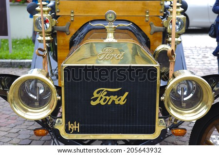 LANDSBERG, GERMANY - JULY 12, 2014: Public oldtimer rally in Bavarian city Landsberg for at least 80 years old veteran cars with a front view of Ford T Torpedo, built at year 1911 - stock photo