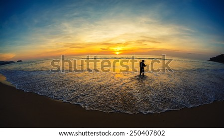 landscape. a decline, the fisherman on the seashore - stock photo
