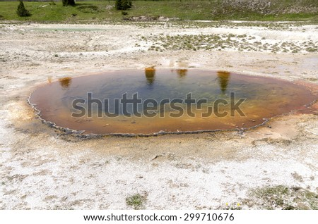 landscape and Geyser in Yellowstone National Park - stock photo
