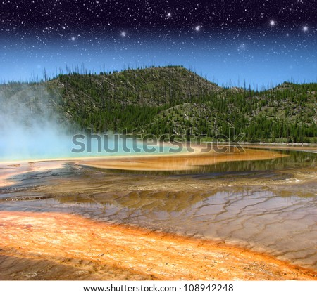 Landscape and Geysers of Yellowstone National Park at Night - USA