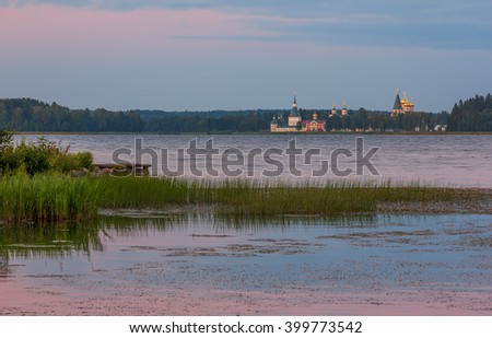 Landscape at Lake Valdai summer evening. View of the Iberian Virgin Svyatoozersky Monastery - stock photo