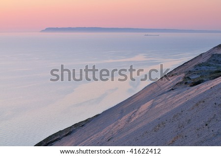 Landscape at twilight of sand dune, freighter, and waters of Lake Michigan, Sleeping Bear Dunes National Lakeshore, Michigan, USA - stock photo