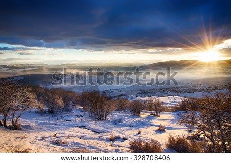 landscape, beautiful view of the snow-covered mountains in the valley at sunrise, painted in warm colors