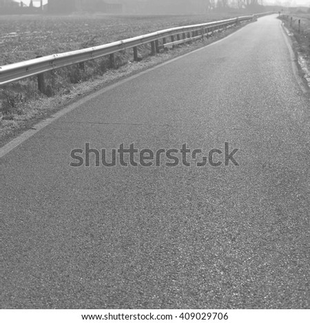 landscape, countryside in autumnal back-light and mist, BW - stock photo