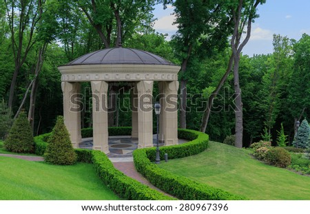 landscape design. Backyard Garden with  narrow road to the arbor - stock photo
